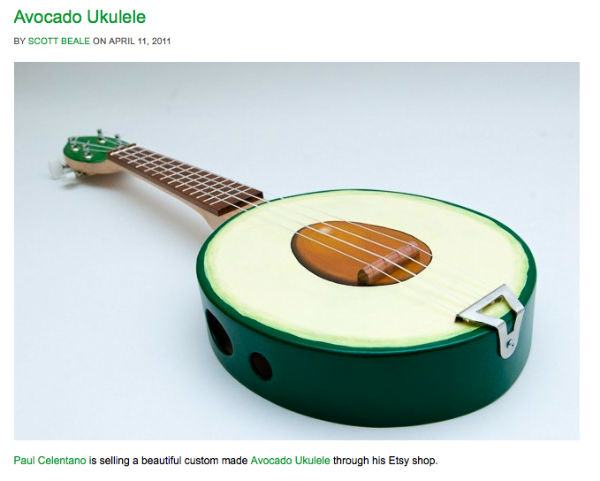 A Ukulele shaped like an avocado.